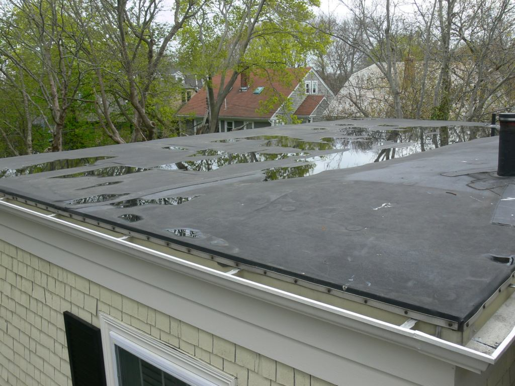 Lots Of Ponding. The Result Of Irregular Roof Framing.