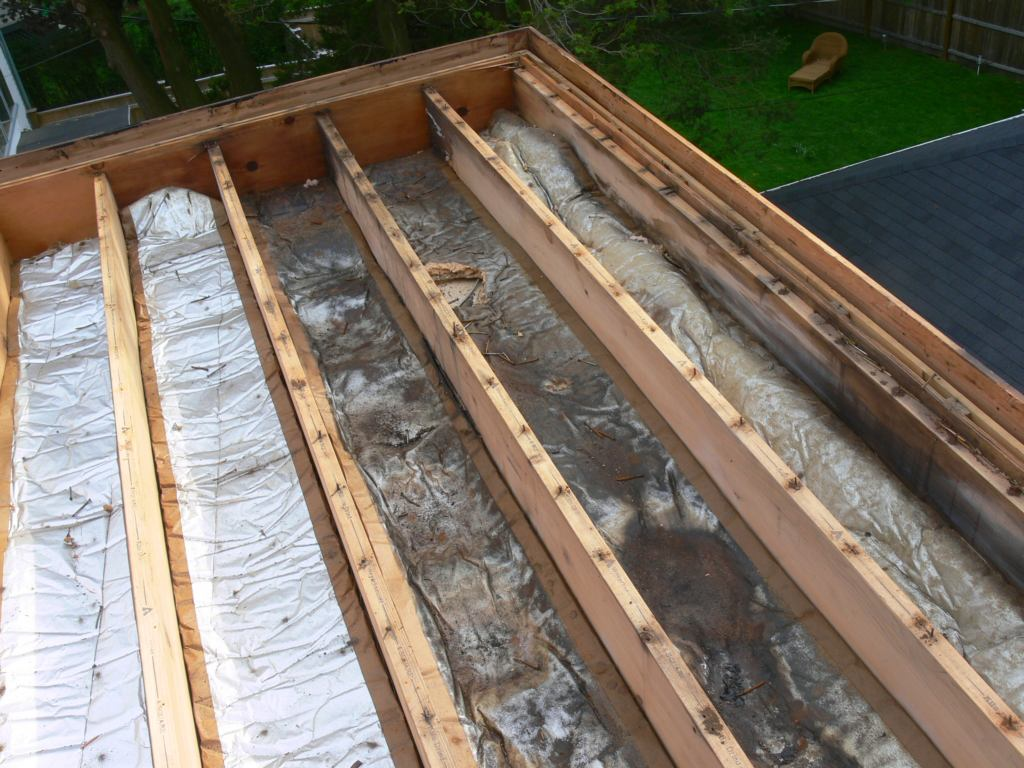 Flat Roof Framing : Demolition of a flat roof in preparation for roofing with