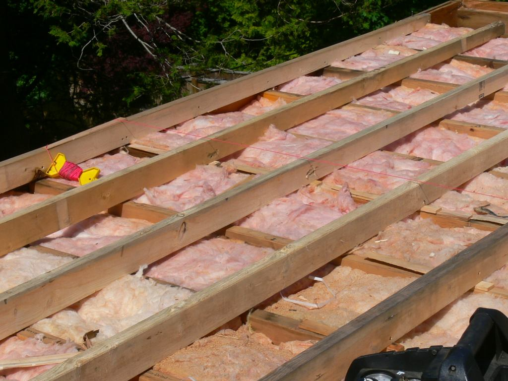 Framing a flat roof with slight pitch in preparation for ...
